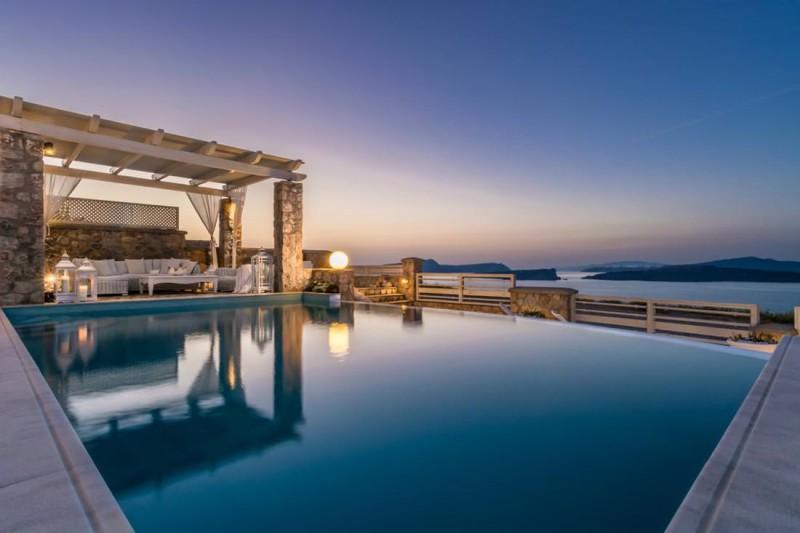 pool at dusk luxury santorini villa for rent