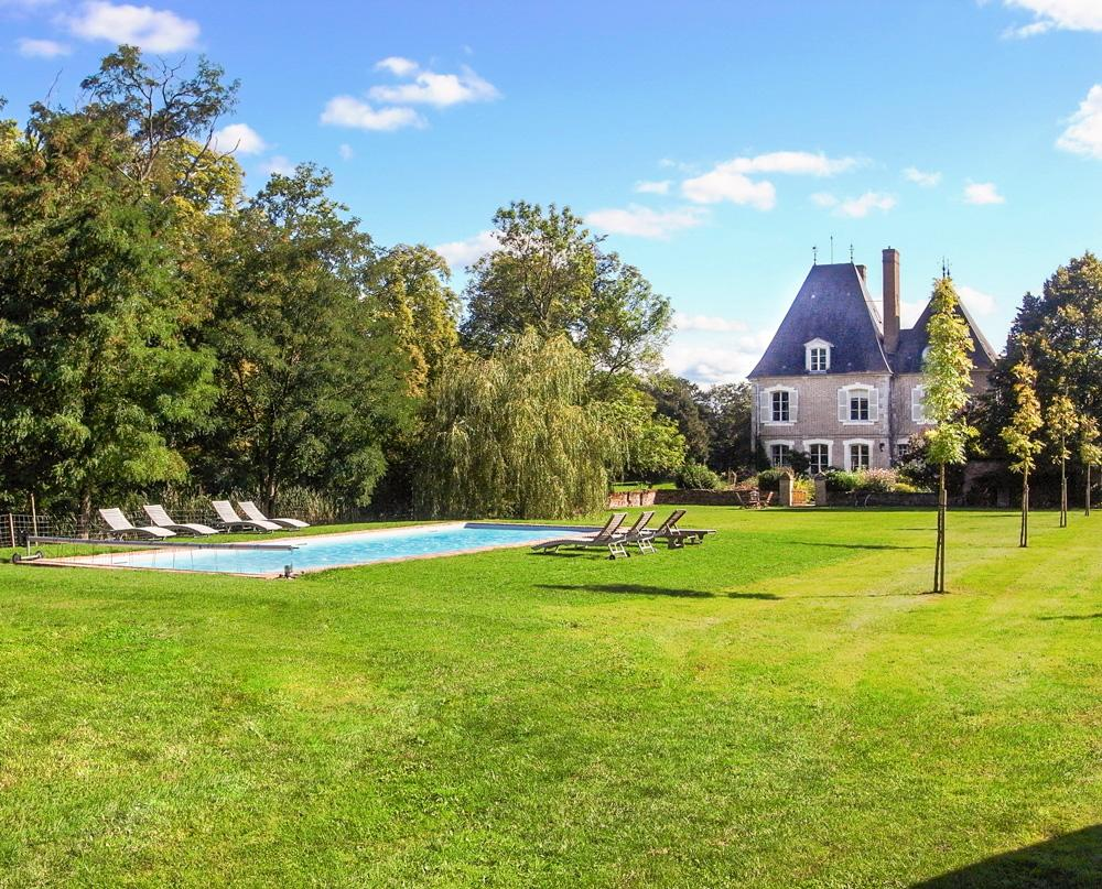 Castle with a pool in Loire valley day time
