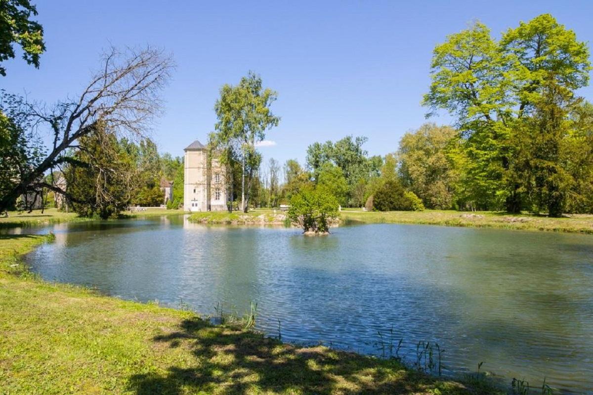 The chateau's parkland with streams, bridges, lake