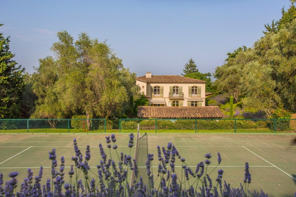 Tennis court of the villa in Cannes France with pool