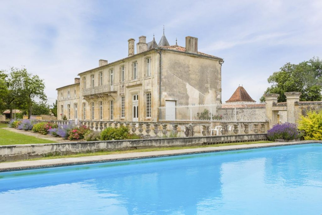 Chateau and pool outdoors