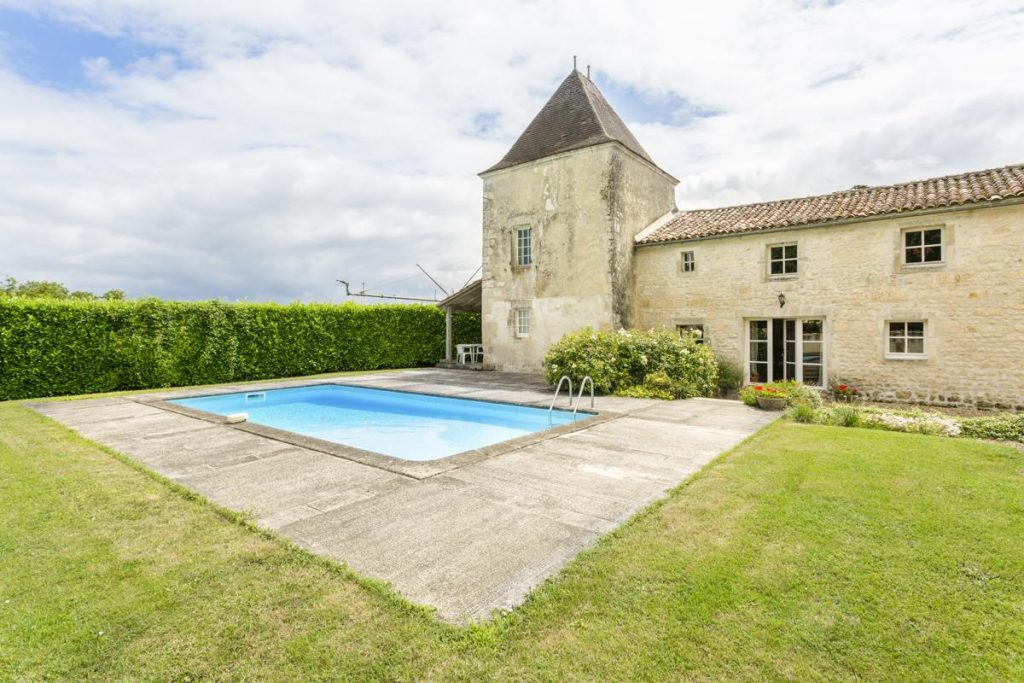 Pool and castle outdoor French wedding chateau rental in Aquitaine