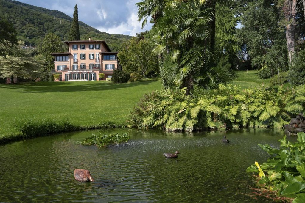 Outdoors gardens space large luxury villa with a pool in Lake Como, Italy
