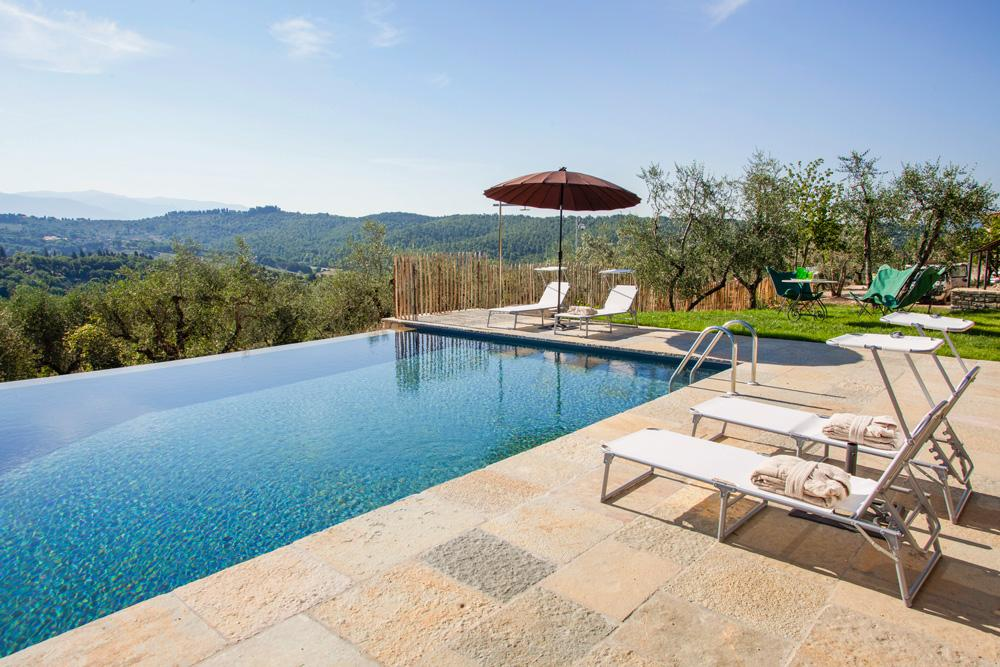 Olive gardens form the Pool Sun loungers Luxury villa near Florence with a pool