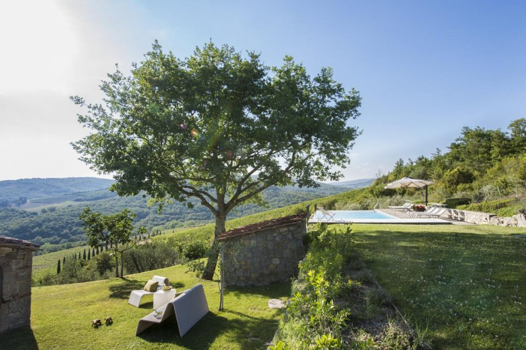 Kids outdoor play area at the villa Tuscany with a Pool