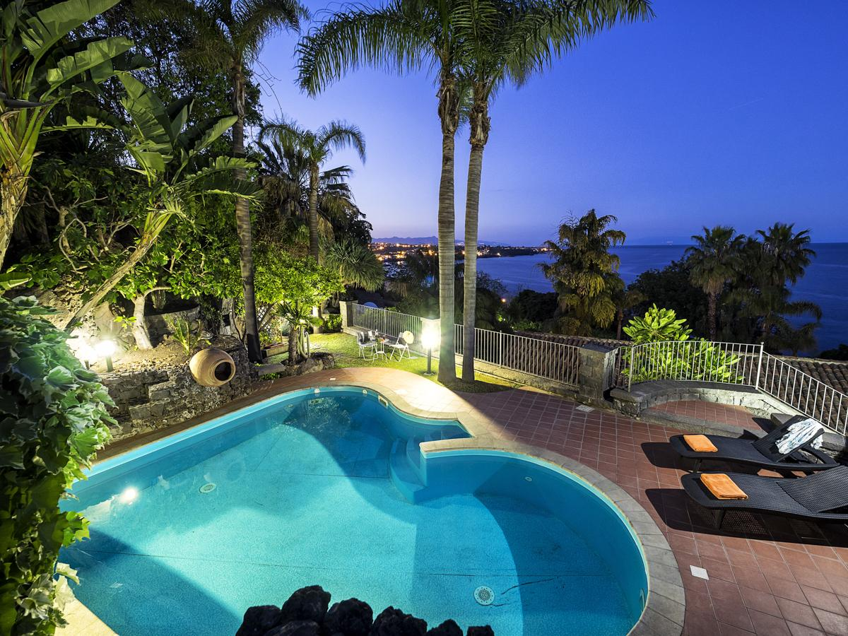 Swimming pool by sunset luxury holiday villa in Catania, Sicily
