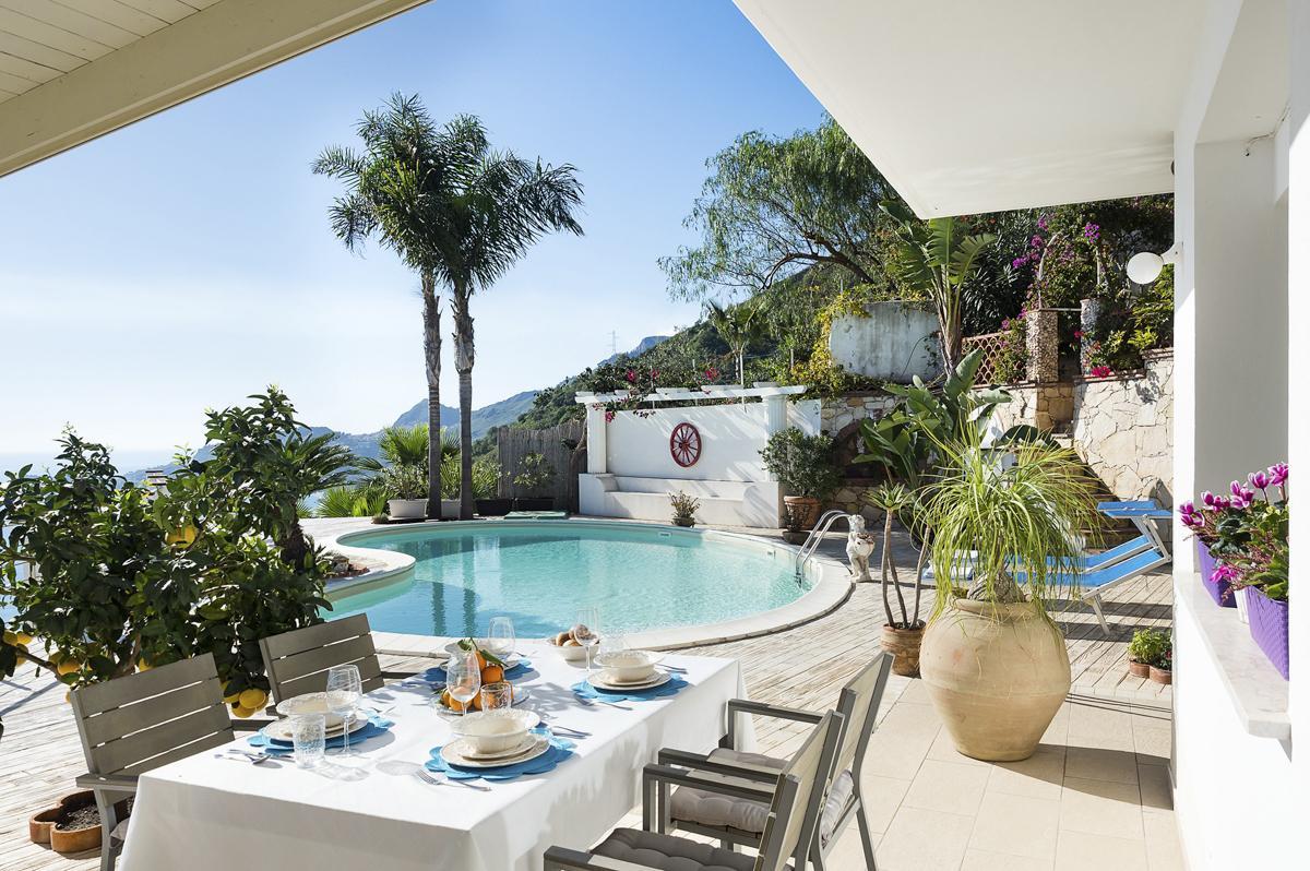 outdoor sitting Luxury Sicily villa with pool near a beach