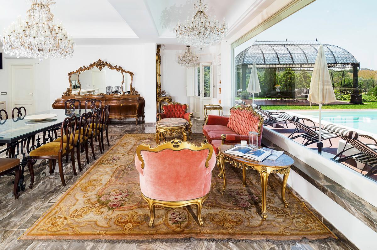 Interior living area sofa with outdoor access Luxury Mediterranean villa in Sicily