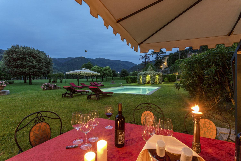 evening pool garden light Lucca luxury wedding villa in Italy