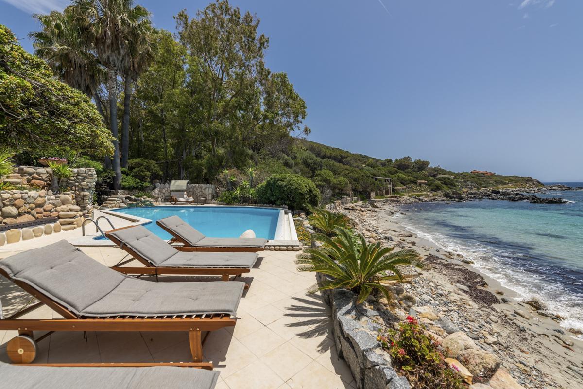 Pool by beach Luxury Cagliari villa with a pool on the beach in Sardinia