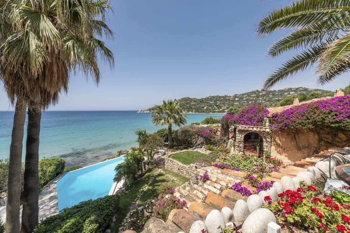 View pool, garden, beach Luxury Cagliari villa with a pool on the beach in Sardinia