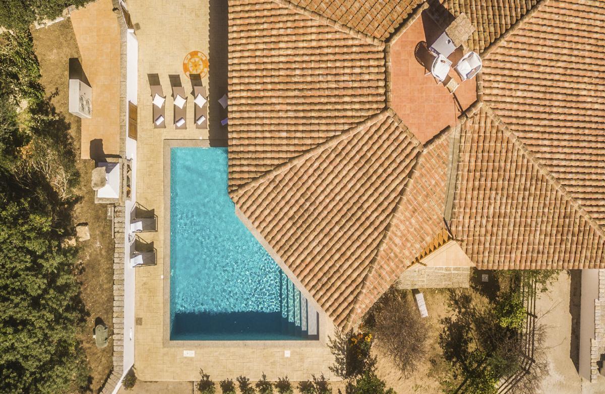 Drone view pool house budget sardinian villa italy