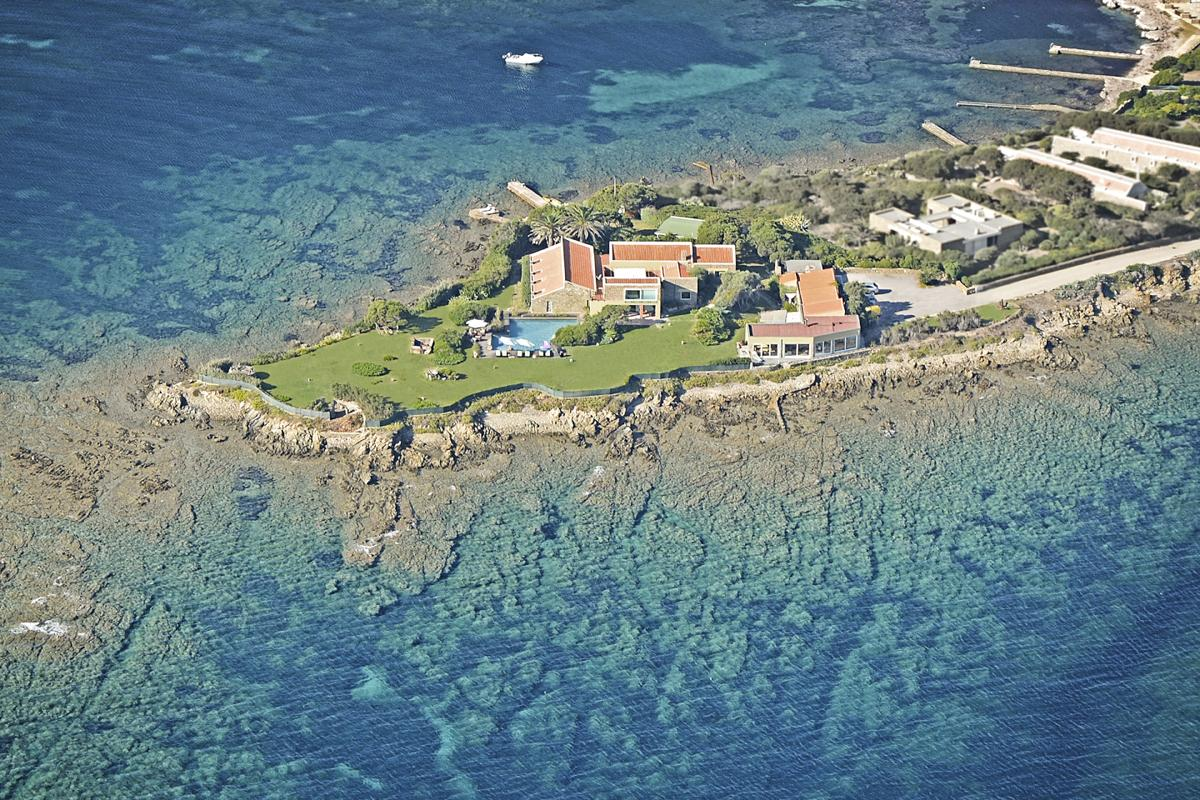 Drone view from above Luxury beach villa with a pool in Sardinia