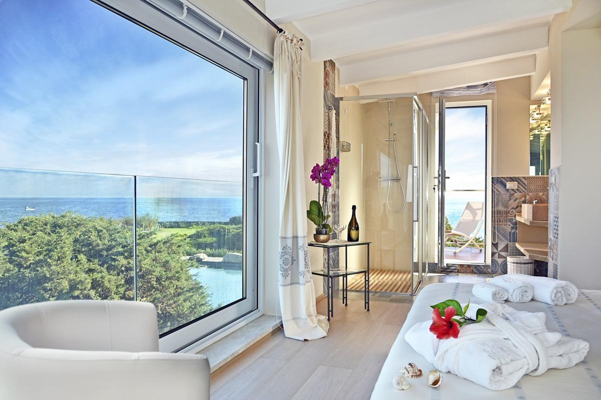 First floor Master Suite superb view of the pool and sea