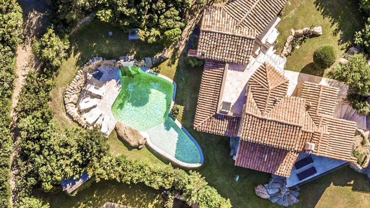 Drone over view garden pool luxury holiday villa sardinia